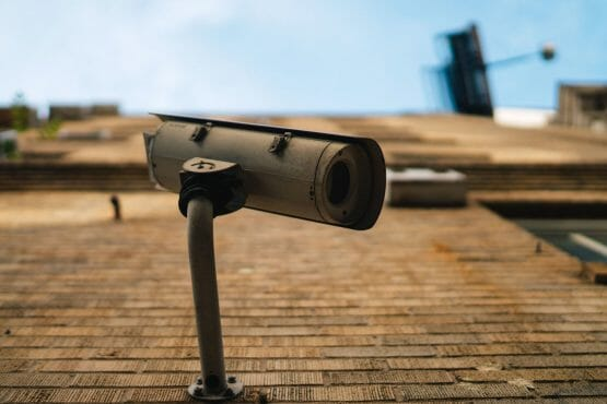 a battery powered security camera is on the wall spying for security threats