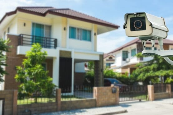 Cctv Camera With House And Village