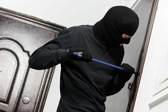 A Burglar trying to get into the house