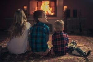 Children By The Fireplace