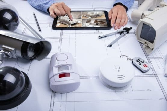 an architect who reviews his plan for installing all types of security camera at his clients home