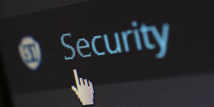 a pointer finger cursor pointing to the word Security