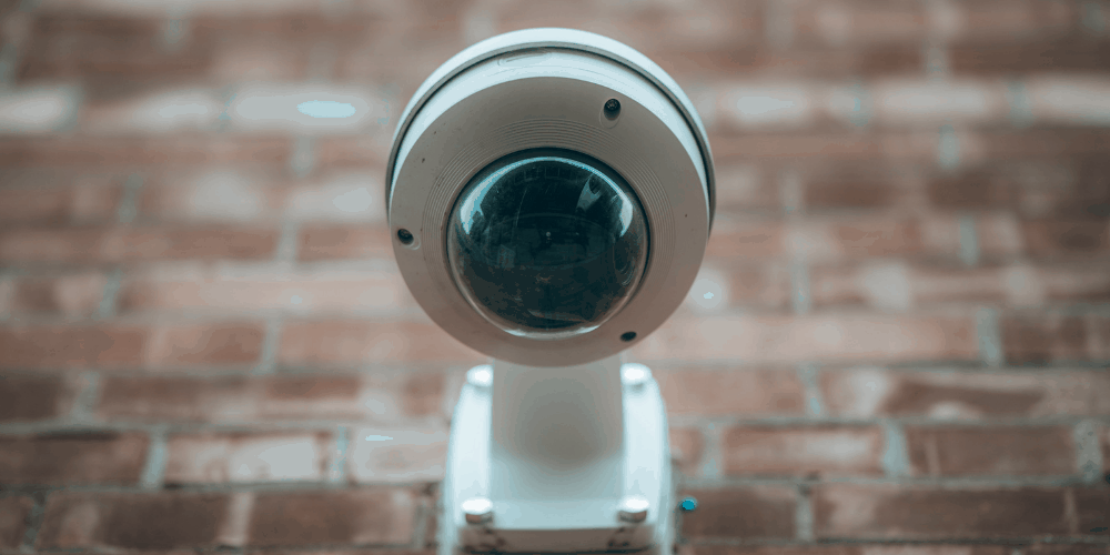 PTZ camera mounted in a wall facing the street
